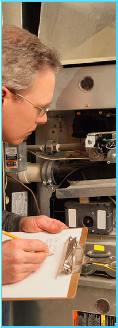 central-heating-repairs-manchester-rt-gas-and-heating-man-inspecting-furnace